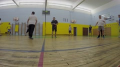 Amateur volleyball game in gym. Timelapse Stock Footage