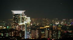 Cityscape with unknown flying objects at night. Timelapse Stock Footage