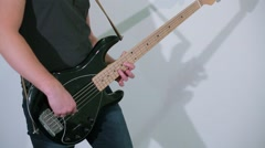Man plays on electric guitar at studio with white background Stock Footage