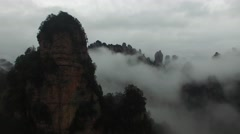 AERIAL CRANE SHOT REVEALING ZHANG JIA JIE AVATAR MOUNTAINS IN FOG AND MIST Stock Footage