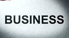 The Words Business on paper Burning in Flames to Ashes. Stock Footage