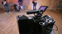 People work near camera equipment with display in studio Stock Footage