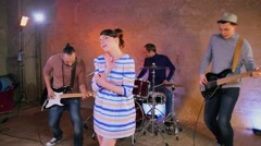 Woman sings in four people band during survey in studio Stock Footage