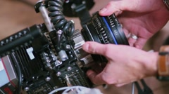 Man prepares professional camera in Moscow, Russia Stock Footage