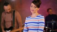 Three people band with singer performs during survey in studio Stock Footage