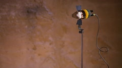 Professional spotlight on support works near wall in studio Stock Footage