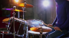 Drummer plays in studio with light equipment during survey Stock Footage