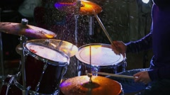 Musician hits wet drums in dark studio during survey Stock Footage