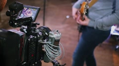 Operator shots guitarist with professional camera equipment in studio Stock Footage