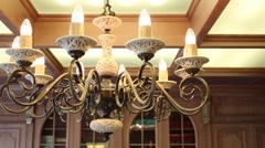 Chandelier with lamps in shape of candles in cabinet Stock Footage