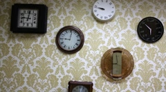 The six different wall clock hanging on the wall in room Stock Footage