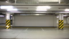 The car parks at the wall in the underground parking garage Stock Footage