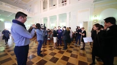 People and reporters in hall during opening of season Yasnaya Polyana Stock Footage