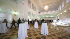 Tables and a crowd of people in a large hall in Pashkov house Stock Footage