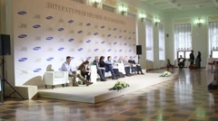Men sitting on chairs on the stage in the hall of Pashkov house Stock Footage