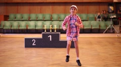 Little girl in a plaid shirt participate in dance competitions Stock Footage