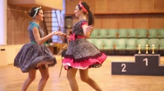 Two smiling girls dancing at the competition in the dance school Stock Footage
