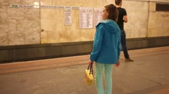Girl waiting for the train at the subway station Teatralnaya Stock Footage