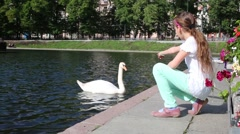 Girl resting on the Patriarchal pond where swans swim Stock Footage