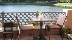 Cozy table and two chairs at Patriarch Ponds on a sunny day Stock Footage