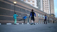 Five children playing ball in the yard of an apartment house Stock Footage