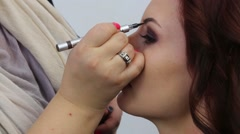 Professional make-up artist doing make-up using eyebrow pencil Stock Footage