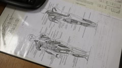 Drawing the human body structure on the desktop of the doctor Stock Footage