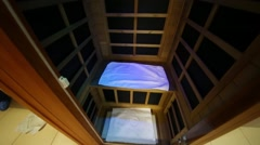 The cabin of infrared saunas with towels in a rehabilitation center Stock Footage