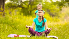 Mom and daughter eats meditate Stock Footage