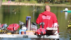 Table with models of boats and man near Big Putyaevsky Pond Stock Footage