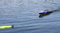 A toy boat in the water pushes the other boat which capsized Stock Footage