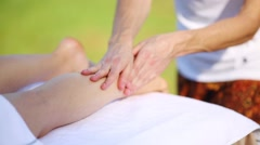 Young woman receiving a foot massage at the open air Stock Footage