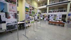 Spacious hall with the stands on which are posters on healthy lifestyles Stock Footage
