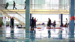Rescue workers and journalists by the pool in the Training Center Stock Footage