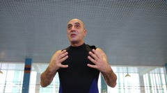 A man talks about first aid at the pool in the Training Center Stock Footage