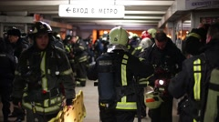 Firefighters are training for emergency situations in hall of metro station Stock Footage