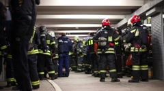 Many firefighters are training for emergency situations in hall Stock Footage