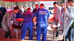 Medical workers are prepared to move on stretcher injured man Stock Footage