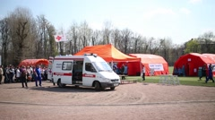 An ambulance is near a multifunctional mobile hospital Stock Footage