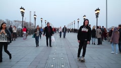 People walk on the Patriarchal bridge in the evening. Stock Footage
