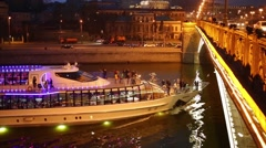 Pleasure boat floats under the Patriarchal bridge in Moscow Stock Footage