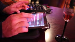 Male hand adjust the audio track on the tablet and the control panel Stock Footage
