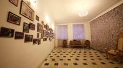 The interior of a small room with armchairs and pictures on the wall Stock Footage