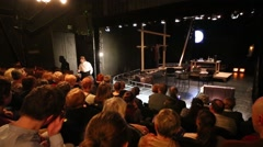People in the audience at a performance Kosmos in theater Modern Stock Footage