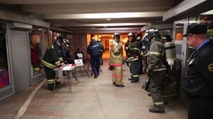Firefighters and rescue workers in transition near the metro Stock Footage