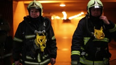 Two fireman are in transition near metro Preobrazhenskaya Square Stock Footage