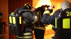 Firefighters wear masks in the transition near the metro Stock Footage