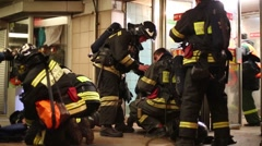Firefighters near the exit of subway station Preobrazhenskaya Square Stock Footage