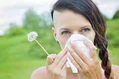 Young woman suffering spring pollen allergy Stock Photos