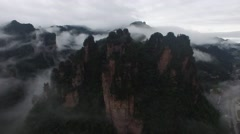 CINEMATIC R2L PAN SHOT OF ZHANGJIAJIE AVATAR MOUNTAINS IN THE FOG AND MIST CHINA Stock Footage
